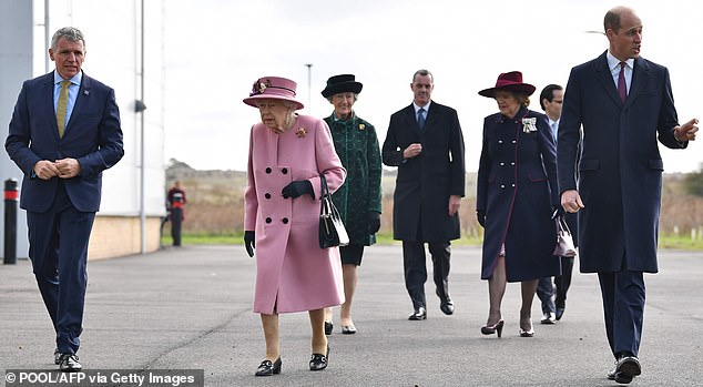 The 94-year-old monarch,wearing a Stewart Parvin old rose cashmere coat teamed with a matching hat by Rachel Trevor Morgan, was joined by her grandson the Duke of Cambridge yesterday