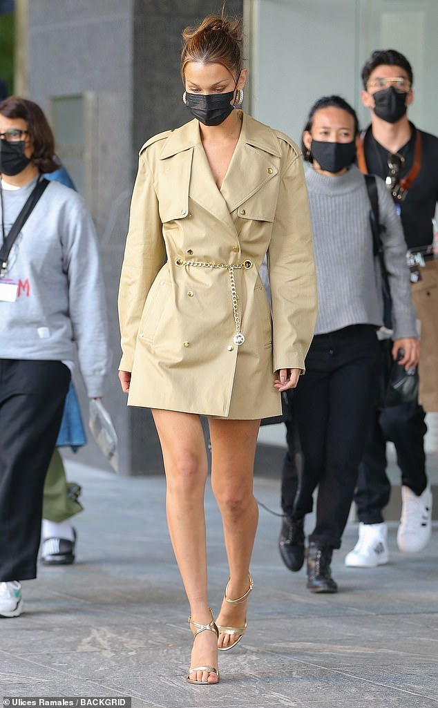 Chic:Bella Hadid was back to her model behavior on Friday as she flaunted her long, toned legs in a blazer dress in NYC