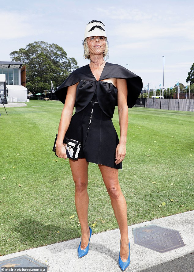Fashion Forward: The 40-year-old co-founder of PE Nation showed her sensational figure in a stylish ensemble at the Everest Cup Racing Carnival