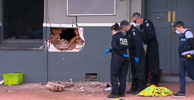 The hole caused by the vehicle impact in the wall of the Crown Hotel in Collie, south of Perth in Western Australia
