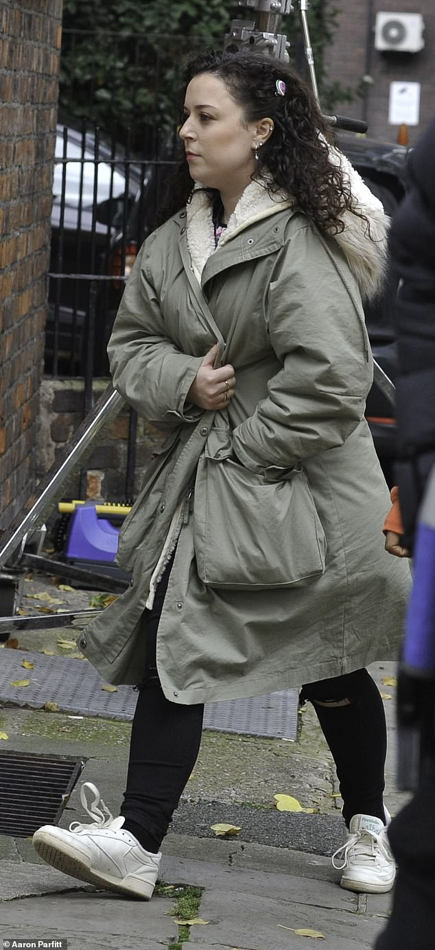 She's back! Tracy Beaker star Dani Harmer was wrapped up warm on set on Friday as she continued filming scenes for the new series at History Nightclub in Manchester's City Centre