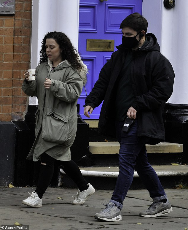 Scenes: The actress, 31, bundled up in a khaki coat as she strolled alongside a crew member as production continued on the BBC adaptation of Jacqueline Wilson's My Mum Tracy Beaker