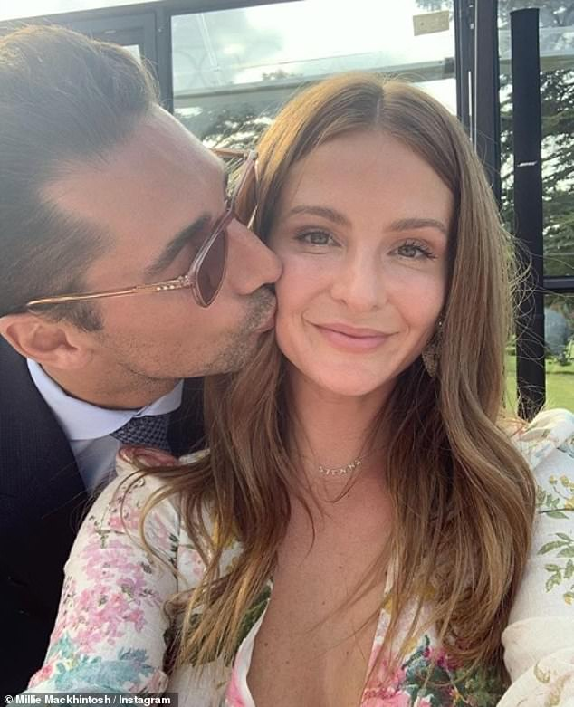 Sweet: Millie shares her daughter Sienna with husband Hugo Taylor (pictured together in September)