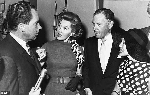 Richard M. Nixon, then Republican candidate for governor of California, speaks with Fleming, actor George Murphy and actress-singer Jane Powell in Hollywood in 1962