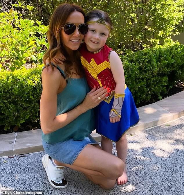 Cute: Kyly Clarke was getting in the Halloween spirit early on Saturday. The 39-year-old shared a photo on Instagram in which she posed alongside her daughter, Kelsey Lee, four, who was wearing a Wonder Woman costume. Both pictured