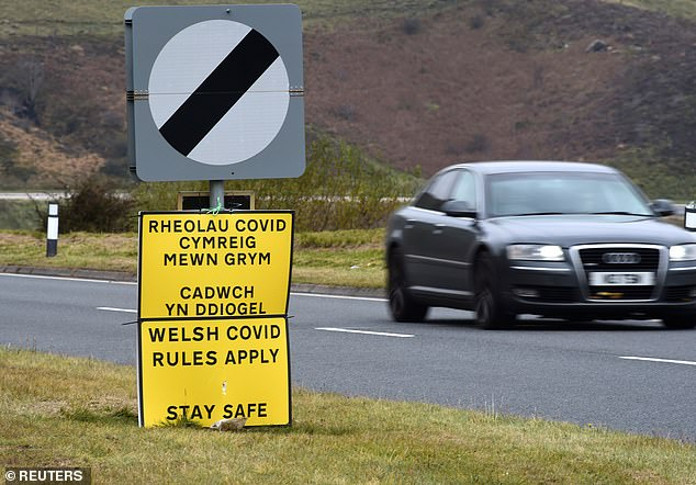 One notice that read 'Welsh Covid Rules Apply' had been erected by the road side in Libanus,Powys
