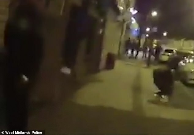 Footage shows party-goers frantically jumping the wall to get away afterpolice raidedan illegal rave in Walsall, in the West Midlands, on September 14