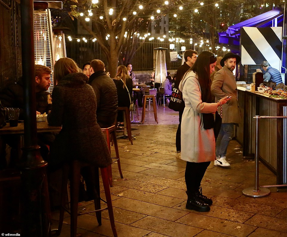 An outdoor food stand in borough market had plenty of business on Saturday night as Kate Nicholls, Chief Executive of UK Hospitality, warned revenue across bars and restaurants in central London has plunged by 85 per cent