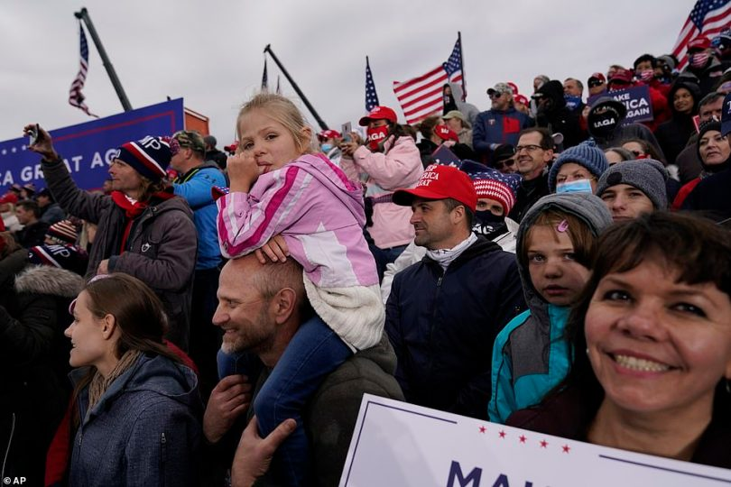 Maskless crowds listen to Trump hit out at Michigan's Democratic Gov. Gretchen Whitmer for keeping the state locked down