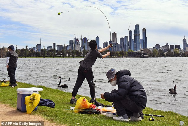 The Herald Sun reported Melburnians will also be able to exercise or leave their homes for longer than the current two-hour time limit (pictured, Melbourne residents fishing)
