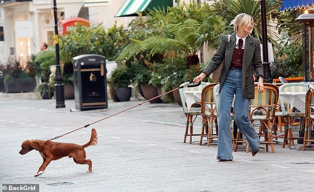 Made in Chelsea star Georgia Toffolo, 25, looked like she was being dragged round London by her beloved King Charles spaniel Monty after she enjoyed lunch with pals