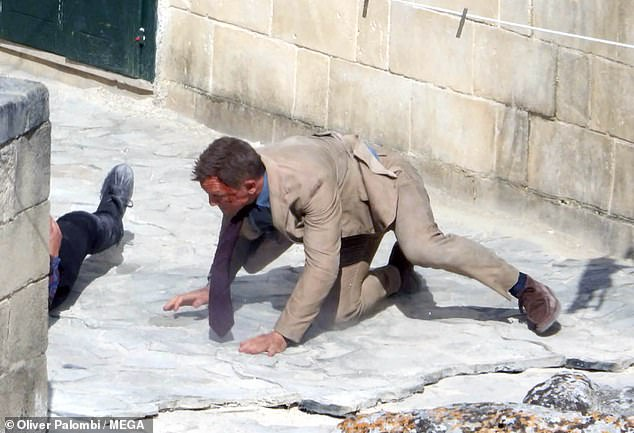 Daniel Craig fighting in the streets of Matera, during filming of the new 007 production
