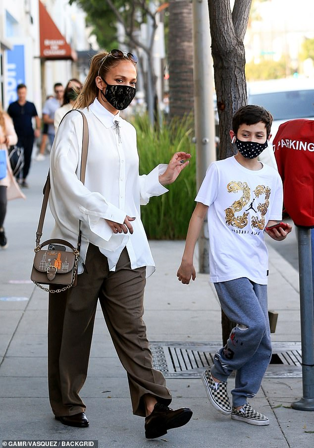 Mom duty: The Wedding Planner actress was snapped with son Max as they left the Kitson store