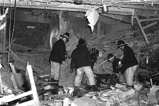 Priti Patel is considering calls for a public inquiry to finally establish the truth behind the Birmingham pub bombings that left 21 people dead and 220 injured. Pictured: Firemen following the bombings in 1974