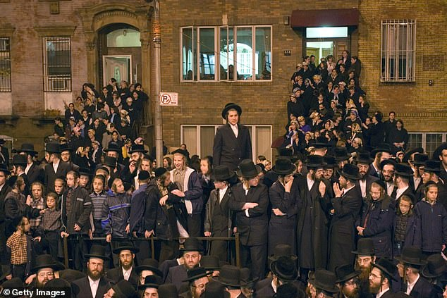 Members of Satmar Hasidic Jewish community outside the Satmar Synagogue on Rodney street in Brooklyn in 2006. A huge 10,000-person wedding was planned for the synagogue for Monday for a grandchild of a notable Hasidic leader