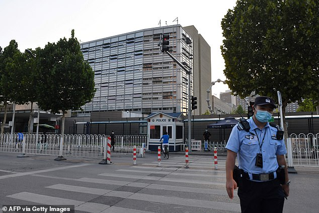 China has warned the US it will take Americans hostage if the Department of Justice doesn't release Chinese research scientists accused of lying about working for the People's Liberation Army, according to sources. Warnings came through the US Embassy in Beijing (above)