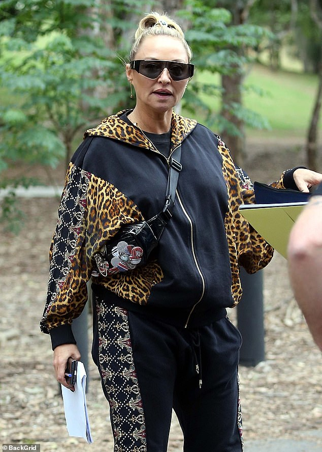 Wild thing: Designer Camilla Franks looked chic in a leopard print bomber jacket which she paired with a bedazzled bottoms