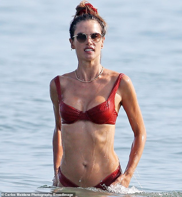 The look: Alessandra slipped into a red textured bikini that enabled her to show off her chiseled midriff as she took a dip