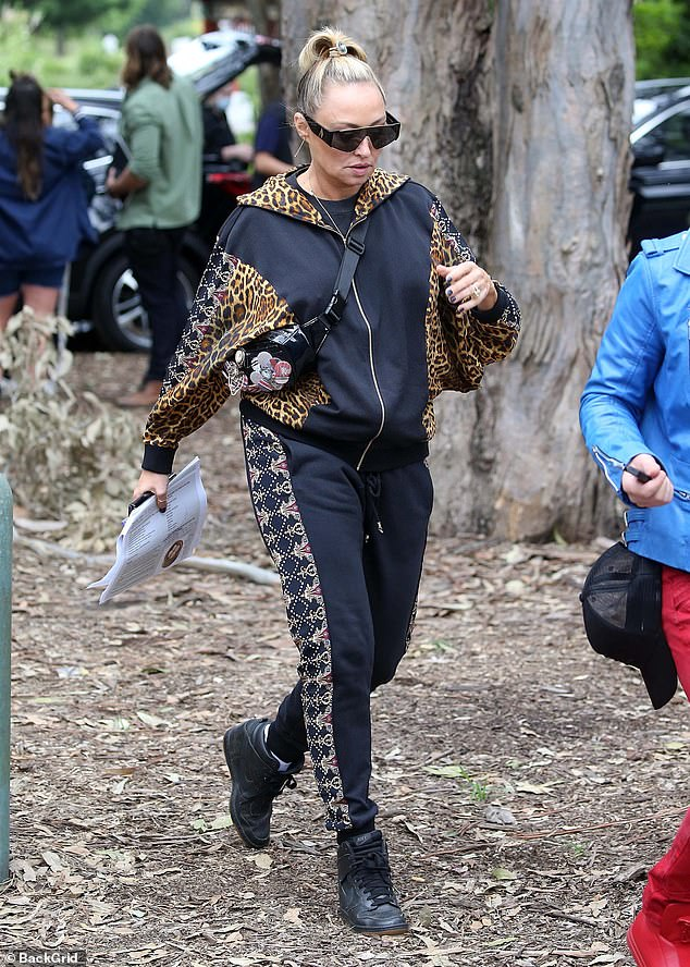 Dressy:Designer Camilla Franks looked chic in a leopard print bomber jacket which she paired with a bedazzled bottoms