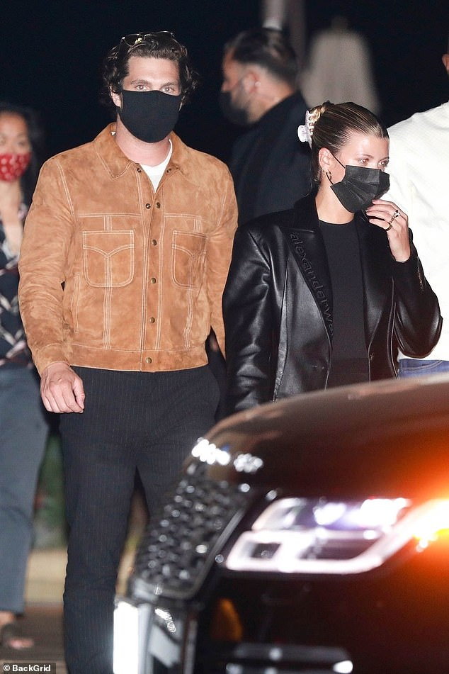 Looking good:The model looked effortlessly chic on the outing where she was also accompanied by a security guard as she made her way in and out of the venue