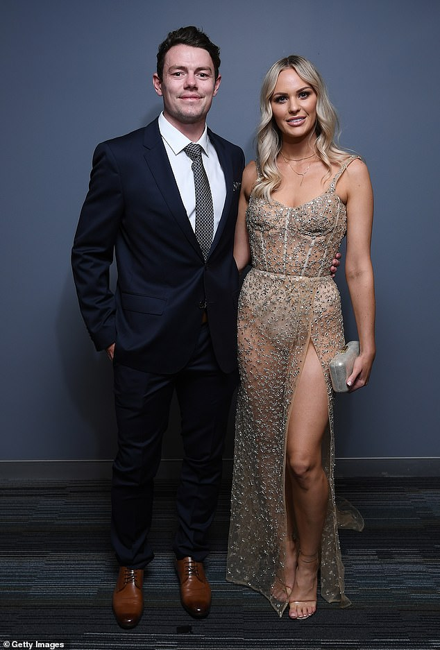 Looking good: The Lions Lachie Neale and his wife Julie Neale made a glamorous entrance at theThe AFL Brownlow Medal ceremony in Brisbane on Saturday