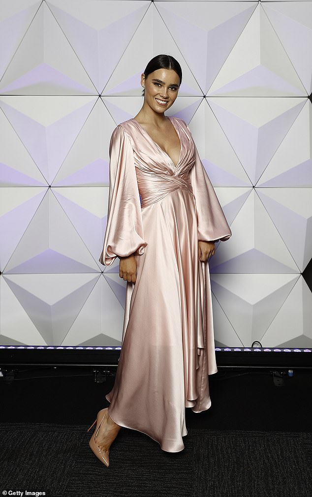 Stunner:She opted for a soft makeup look while wearing her brunette locks off her face, and nude heels to finish the ensemble