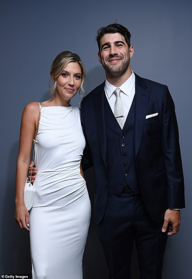 Suited:Christian looked handsome in a three-piece navy suit with an ivory satin tie and white dress shirt