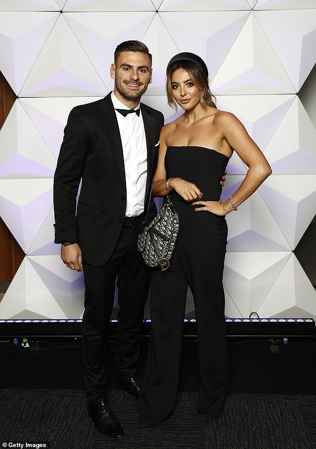 Fashionable pair:Stephen Coniglio of the Giants and partner Rebecca Lauren were clearly up for a fun night, posing in a number of adorable photos upon arrival