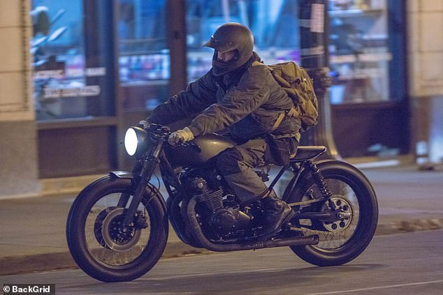 Action:The actor portrays the Penguin in the upcoming blockbuster and wore the character's prosthetics as he filmed the scene on a motorbike