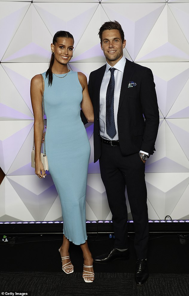 Feeling blue:The Giants Josh Kelly looked dapper in a modern suit with dotted tie, pocket square and a chunky watch, while his partner Lucy Gilkes opted for a baby blue gown