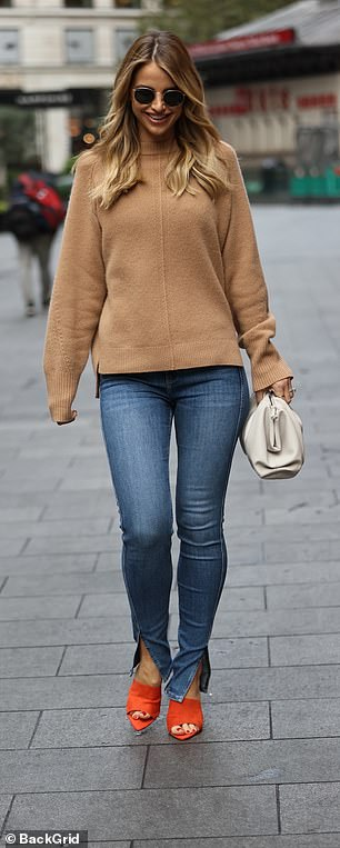 Looking good: The model and TV star looked gorgeous in a brown sweater and skinny jeans as she headed to the Global studios