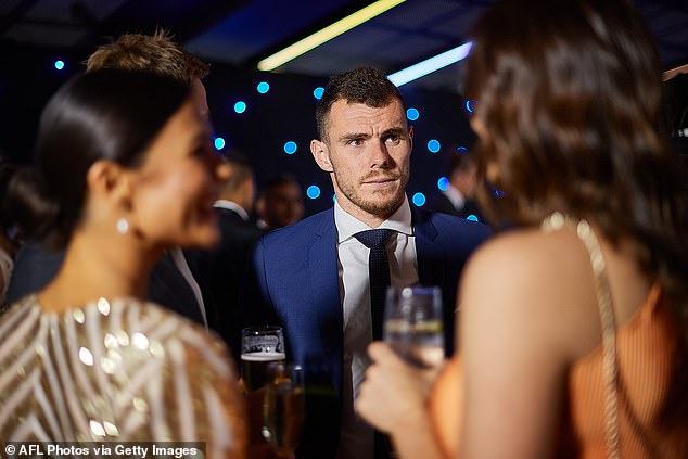 Luke Shuey mingles with other guests as attendees went maskless at Optus Stadium in Perth