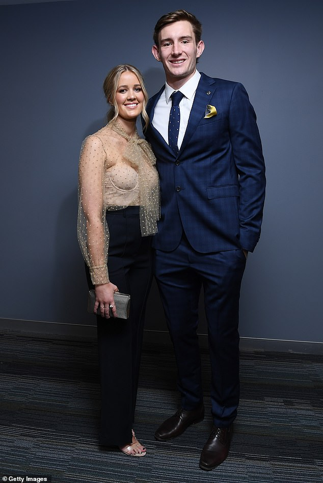 Hip cats:Harris Andrews of the Lions and his partner Emily Halverson looked incredibly chic, with Harris wearing a blue suit with a gold and polka dot pocket square