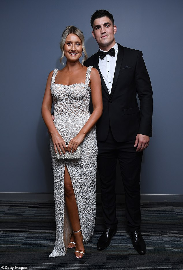 To the nines:Brayden Maynard of the Magpies and his partner Ashlee Browning brought the glamour with Ashlee dressed to the nines in a beaded gown with a sheer base