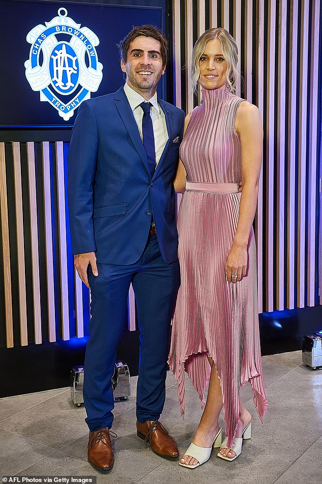 Fun duo:Andrew Gaff of the West Coast Eagles and partner Emma Van Woerden looked ready for a fun night with Andrew in a bright blue suit and Emma opting for a satin, mauve gown with a high neckline, an asymmetric hem and pleating