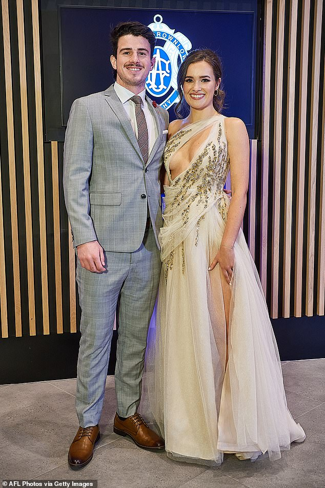 Romantic:West Coast Eagles player Andrew Brayshaw and partner Lizzie Stock made for a glam duo, with Andrew in a grew suit and Lizzie in a daring, beaded gown that showed off a hint of cleavage, as well as a thigh-high split that showed off her slim pins