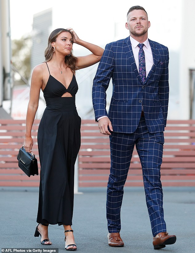Party people:Steven May of the Demons and is partner Briana looked brilliant with Steven in a checked blue suit with a floral tie, while Briana opted for a black evening gown with a plunging neckline and a cutout showing a hint of skin