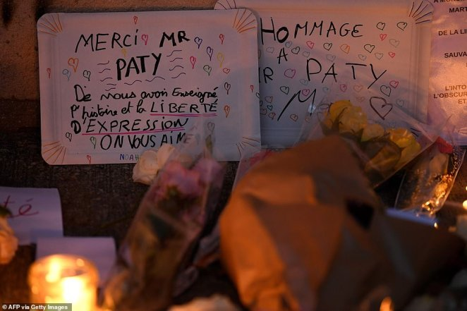 Pupils left messages to the teacher reading 'Thank you Mr. Paty to have taught us History and Freedom of Speech, We love you' (left) and 'Hommage to Mr. Paty' (right)