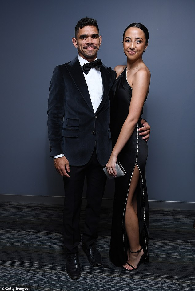 Cool couple:Charlie Cameron of the Lions and his partner Caitlin Seeto made a chic entrance in sophisticated looks, with Charlie wearing a black velvet tuxedo and bow tie