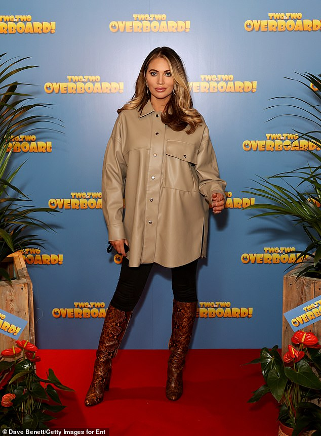 Chic:Former TOWIE star Amy Childs, 30, came in a striking beige leather jacket dress, which she coupled with a set of red snake-print inspired boots