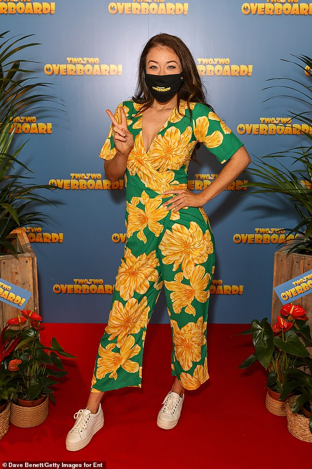 Masked up:Ex on the beach star Jess Impiazzi, 31, arrived in a rush of colour, as she wore a stunning bright green and yellow floral jumpsuit