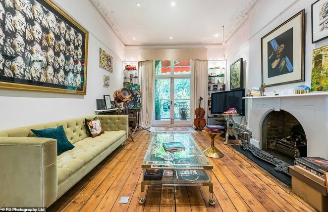 Ronnie Wood's townhouse where the musician swapped his raucous rocker lifestyle for a relaxed family life has gone on sale for £3.85 million. Pictured: a spacious sitting room featuring an art easel and musical instruments