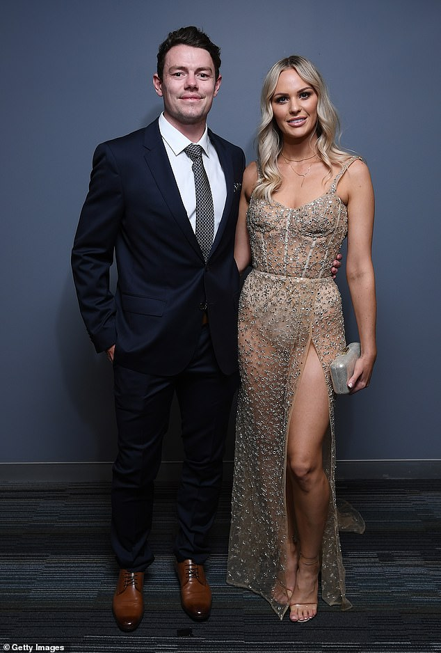 All eyes: Lachie Neale's (left) wife Julie Neale (right) was left in tears when he dedicated his 2020 Brownlow Medal win to her on Sunday night. But while Lachie, 27, was victorious on the night, all eyes were on his glamorous, 30-year-old wife of two years