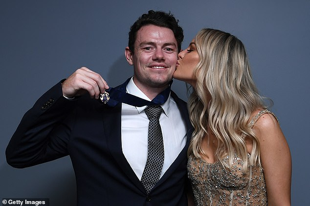 Smooch: Julie planted sweet kisses on Lachie's cheek as he showed off his medal