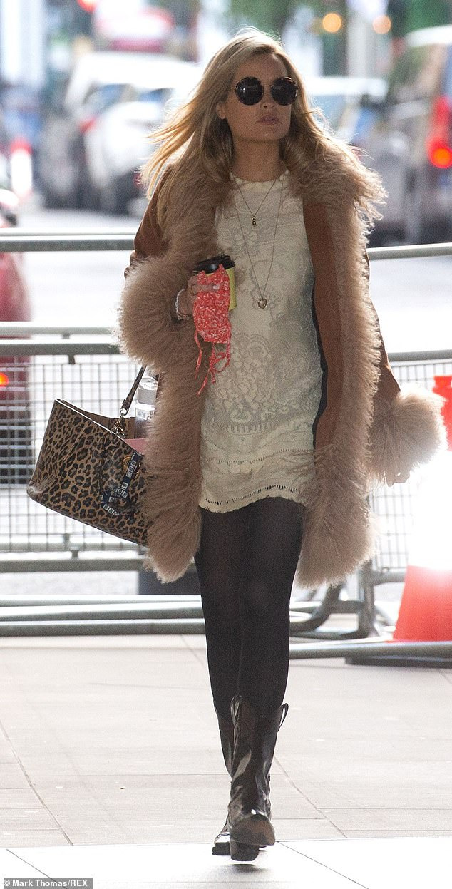 Looking fab:Laura Whitmore was hard at work on Sunday, strolling to the BBC studios in London for her 5Live radio show