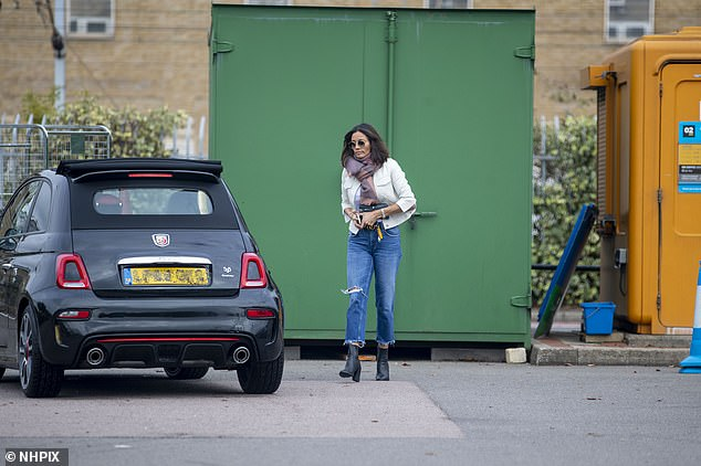 Back down to Earth: She was seen clutching her phone as she headed to her car