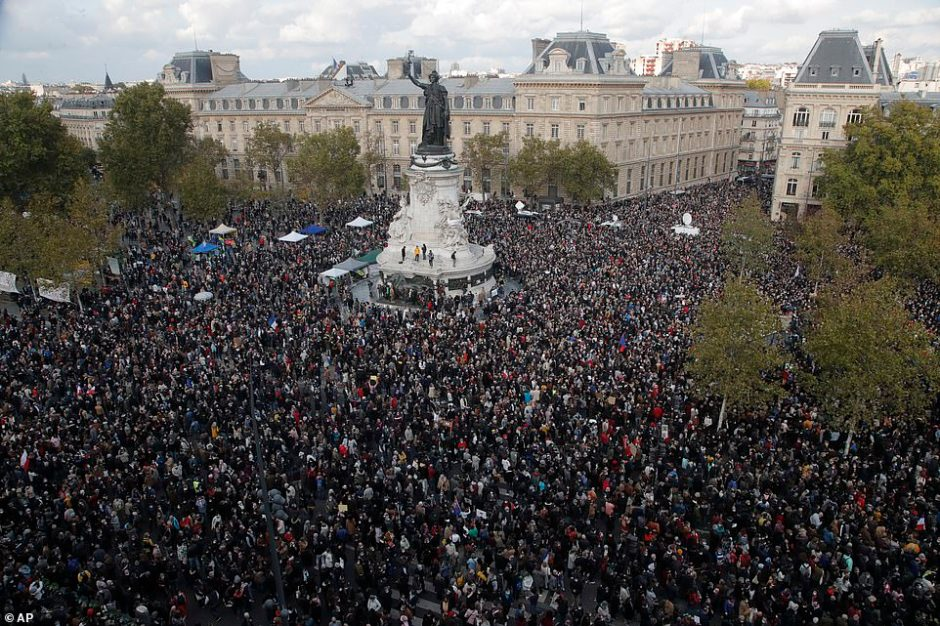 Thousands gathered in Place de la Reublique on Sunday to pay their respects to the teacher and show their support for freedom of speech