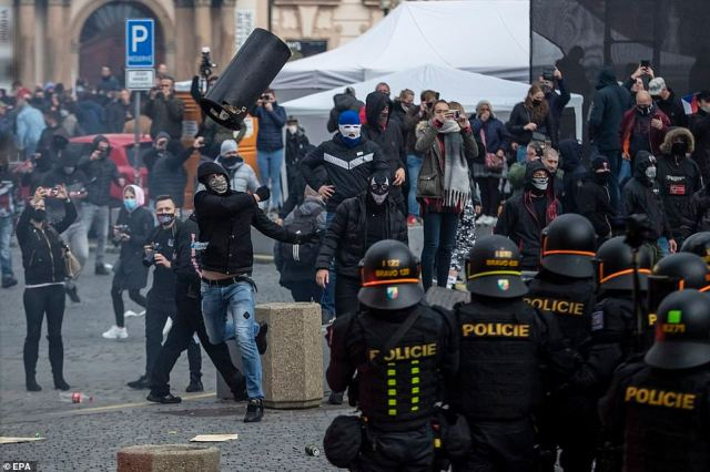 Hundreds of demonstrators, mostly hooligans, clash with police during a protest against the Czech government's new Covid-19 measures
