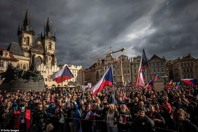 Demonstrators gather to protest against the COVID-19 restrictive measures at Old Town Square on October 18.Czech police used tear gas and a water cannon to disperse hundreds of violent protesters who attacked them