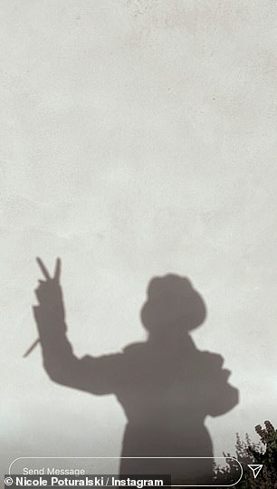 Cute:The star also photographed her shadow while she gave a peace sign